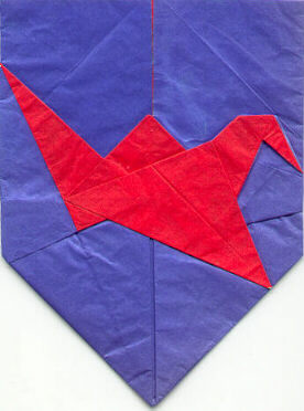 Shield with flapping bird (logo of British Origami Society)